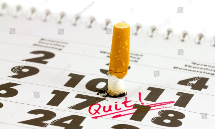 -time-to-quit-smoking-cigarette-butts-on-the-calendar-concept-of-choosing-a-day-to-quit-smoking-144432331